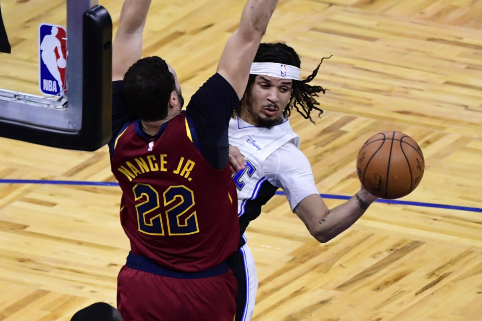 ORLANDO, FLORIDA - JANUARY 04: Cole Anthony #50 of the Orlando Magic looks to pass the ball as Larry Nance Jr. #22 of the Cleveland Cavaliers defends during the first half at Amway Center on January 04, 2021 in Orlando, Florida. NOTE TO USER: User expressly acknowledges and agrees that, by downloading and or using this photograph, User is consenting to the terms and conditions of the Getty Images License Agreement.
