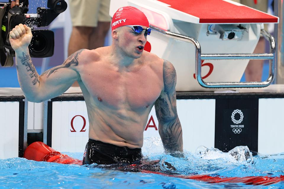 Adam Peaty wins 100m breaststroke gold at the Tokyo Olympics, the first Brit to defend a swimming title at the Games