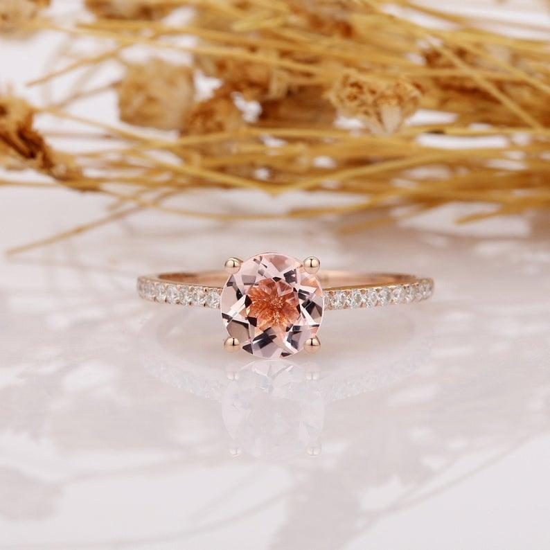 """<p>Their eyes will light up once they see this pink <a href=""""https://www.popsugar.com/buy/14k-Rose-Gold-Round-Cut-Morganite-Pave-Set-Engagement-Ring-531231?p_name=14k%20Rose%20Gold%20Round%20Cut%20Morganite%20Pave%20Set%20Engagement%20Ring&retailer=etsy.com&pid=531231&price=495&evar1=fab%3Aus&evar9=44555978&evar98=https%3A%2F%2Fwww.popsugar.com%2Fphoto-gallery%2F44555978%2Fimage%2F47011780%2F14k-Rose-Gold-Round-Cut-Morganite-Pave-Set-Engagement-Ring&list1=wedding%2Cjewelry%2Crose%20gold%2Cengagement%20rings&prop13=api&pdata=1"""" rel=""""nofollow noopener"""" class=""""link rapid-noclick-resp"""" target=""""_blank"""" data-ylk=""""slk:14k Rose Gold Round Cut Morganite Pave Set Engagement Ring"""">14k Rose Gold Round Cut Morganite Pave Set Engagement Ring</a> ($495).</p>"""