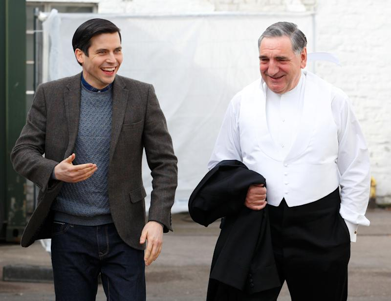 "LONDON, UNITED KINGDOM - MARCH 12: (EMBARGOED FOR PUBLICATION IN UK NEWSPAPERS UNTIL 48 HOURS AFTER CREATE DATE AND TIME) ""Downton Abbey"" cast members Rob James-Collier (Thomas Barrow) and Jim Carter dressed in character as Mr Carson seen prior to the arrival of Catherine, Duchess of Cambridge for a visit to the set of ""Downton Abbey"" at Ealing Studios on March 12, 2015 in London, England. (Photo by Max Mumby/Indigo/Getty Images)"