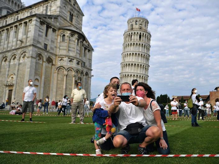 Tourists seen at the tower of Pisa on May 30, 2020.