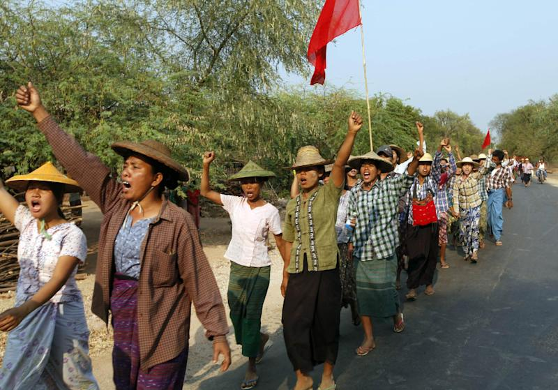 Protesting villagers march and shout slogans as they stage a rally against a recent report on Letpataung copper mine project by investigation commission, in Monywa township, 760 kilometers (450 miles) north of Yangon, central Myanmar, Wednesday, March 13, 2013. Opponents of a nearly $1 billion copper mine in northwestern Myanmar expressed outrage Tuesday over the government-ordered report that said the project should continue and that refrained from demanding punishment for police involved in a violent crackdown on protesters. (AP Photo/Khin Maung Win)