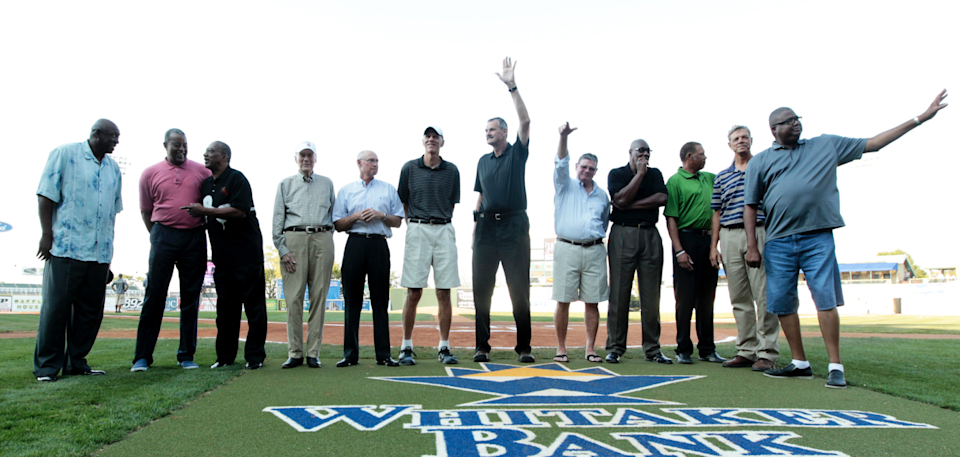 Members of the 1972 Olympic basketball team (from left) Jim Brewer, Mike Bantom, Tom Henderson, John Bach (asst. coach), Kenny Davis, Bobby Jones, Tom Burleson, Kevin Joyce, Jim Forbes, Ed Ratleff, John Brown (asst. coach) and Dwight Jones are introduced before a minor-league baseball game in 2012. (Pablo Alcala/Lexington Herald-Leader/MCT)