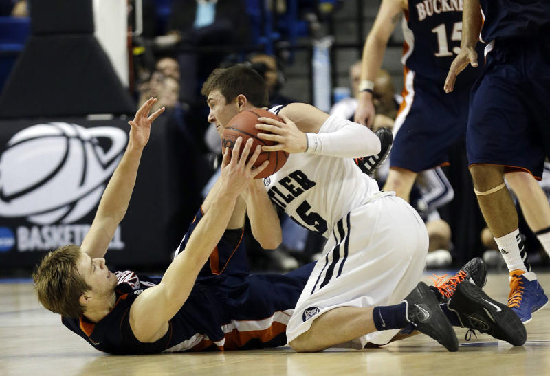 Butler guard Rotnei Clarke (15) comes up with a loose ball against Bucknell guard Steven Kaspar (3) during the second half of their second-round game in the  NCAA college basketball tournament Thursday, March 21, 2013, in Lexington, Ky. Butler won  (AP Photo/John Bazemore