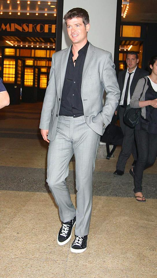 "We typically think pairing sneakers with a suit is a no-no, but in our book, Robin Thicke can do no wrong! Roger Wong/<a href=""http://www.infdaily.com"" target=""new"">INFDaily.com</a> - August 4, 2008"