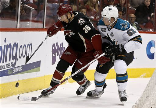 Phoenix Coyotes' Rob Klinkhammer (36) battles San Jose Sharks' Matt Irwin (52) for the puck in the first period during an NHL hockey game, on Monday, April 15, 2013 in Glendale, Ariz. (AP Photo/Ross D. Franklin)