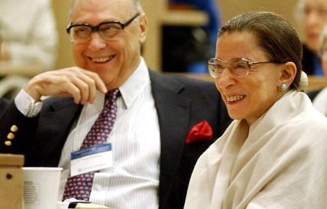 Associate Justice Ruth Bader Ginsburg laughs with her husband Martin as they listen to Justice Stephen Breyer speak at Columbia Law School on Sept. 12, 2003. The occasion celebrated the 10th anniversary of her appointment to the Supreme Court.