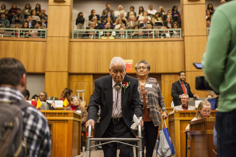 FILE - This Jan. 16, 2018, file photo Sen. John Pinto enters the House chambers on the first day of the New Mexico Legislature at the New Mexico Capitol in Santa Fe, N.M. Pinto, one of the nation's longest serving Native American elected officials, has died at age 94. (AP Photo/Juan Labreche,File)