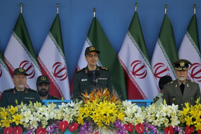 "Iranian General Mohammad Bagheri, seen in 2016, and Russian General Valery Gerasimov, ""condemned the American operation against a Syrian air base which is an aggression against an independent country"", Iranian state news agency IRNA said"