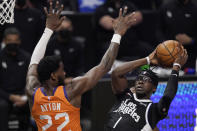 Los Angeles Clippers guard Reggie Jackson, right, shoots as Phoenix Suns center Deandre Ayton defends during the second half in Game 3 of the NBA basketball Western Conference Finals Thursday, June 24, 2021, in Los Angeles. (AP Photo/Mark J. Terrill)