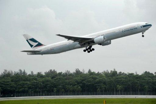 A Cathay Pacific plane takes off from Changi International airport in Singapore