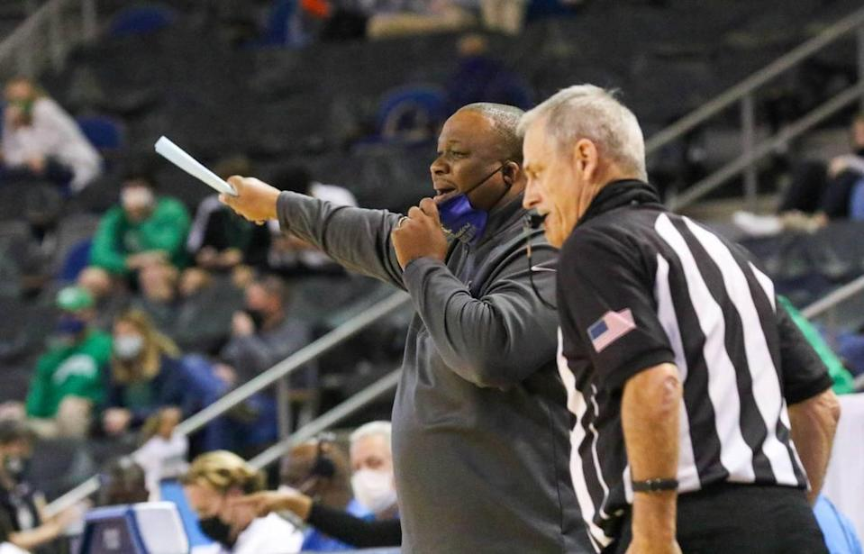 Keenan coach Reggie McLain yells to his team during the 3A state championship game against Bishop England at the USC Aiken Convocation Center on Friday, March 5, 2021.
