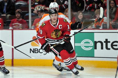 Dec 11, 2013; Chicago, IL, USA; Chicago Blackhawks center Jonathan Toews (19) looks for the puck against the Philadelphia Flyers during the third period at the United Center. The Blackhawks beat the Flyers 7-2. Rob Grabowski-USA TODAY Sports
