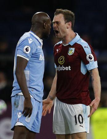 Britain Football Soccer - Burnley v Stoke City - Premier League - Turf Moor - 4/4/17 Burnley's Ashley Barnes clashes with Stoke City's Bruno Martins Indi Reuters / Phil Noble Livepic