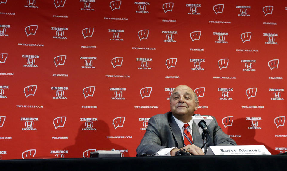 FILE - In this Dec. 6, 2012, file photo, Wisconsin Athletic Director Barry Alvarez announces that he will coach the team in this year's Rose Bowl during a news conference in Madison, Wis. The Big Ten could only fill seven of their eight predetermined bowl slots _ and each of those bowl-bound teams are currently underdogs. From the 5-loss Wisconsin team that still wound up in the Rose Bowl to the 6-6 Purdue squad that fired its coach, the beleaguered Big Ten isn't expected to do much of anything in the postseason. (AP Photo/Morry Gash, File)
