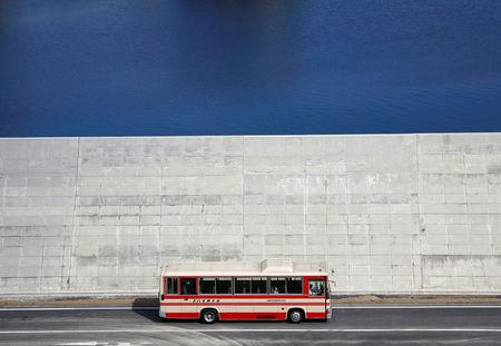 A bus is driven past a seawall in Yamada village, Iwate Prefecture, Japan, March 3, 2018. REUTERS/Kim Kyung-Hoon