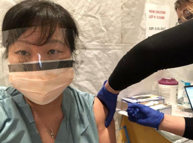 The author receiving her COVID-19 vaccination. (Photo: Courtesy of Thanh Neville, M.D., M.S.H.S.)