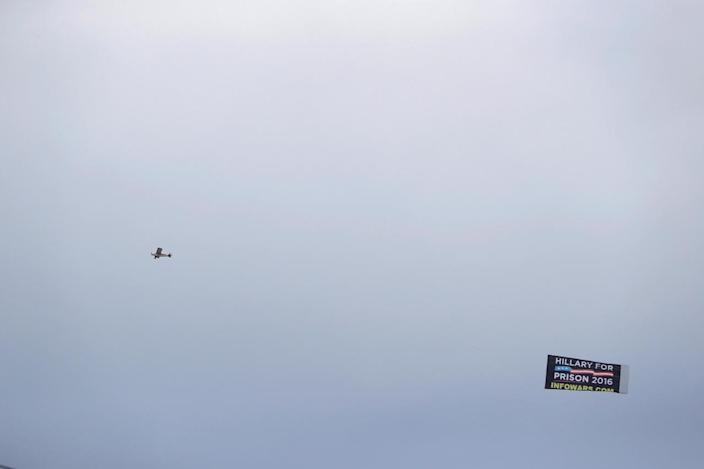 """<p>A plane flies with a banner reading """"Hillary for Prison"""" outside the Quicken Loans Arena as setup continues in advance of the Republican National Convention in Cleveland, Ohio, on July 16, 2016. (Photo: Aaron P. Bernstein/Reuters)</p>"""
