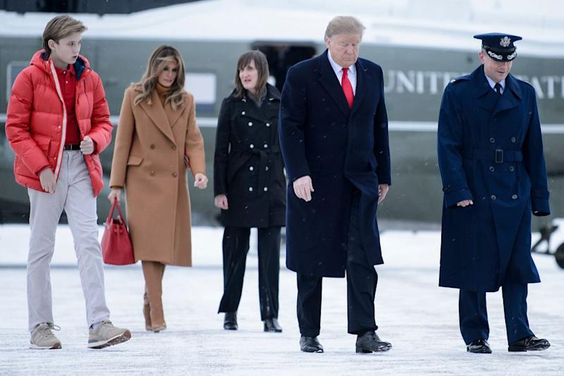 Barron Trump (left) with his parents in February | BRENDAN SMIALOWSKI/AFP/Getty Images