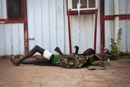 A wounded soldier of the South-Sudan's Sudan People's Liberation Army (SPLA) rests outside the Rubkona Military Hospital