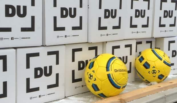 About 300 smart soccer balls were distributed to Feildian players Saturday. The team hopes they'll keep players in touch with the game and each other. (Heather Gillis/CBC - image credit)