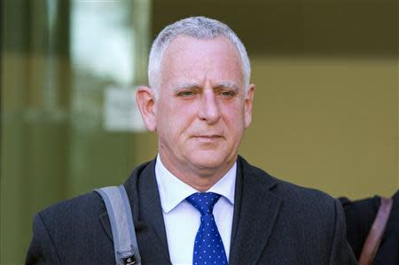 Former Barclays employee Peter Johnson leaves Westminster Magistrates' Court in London
