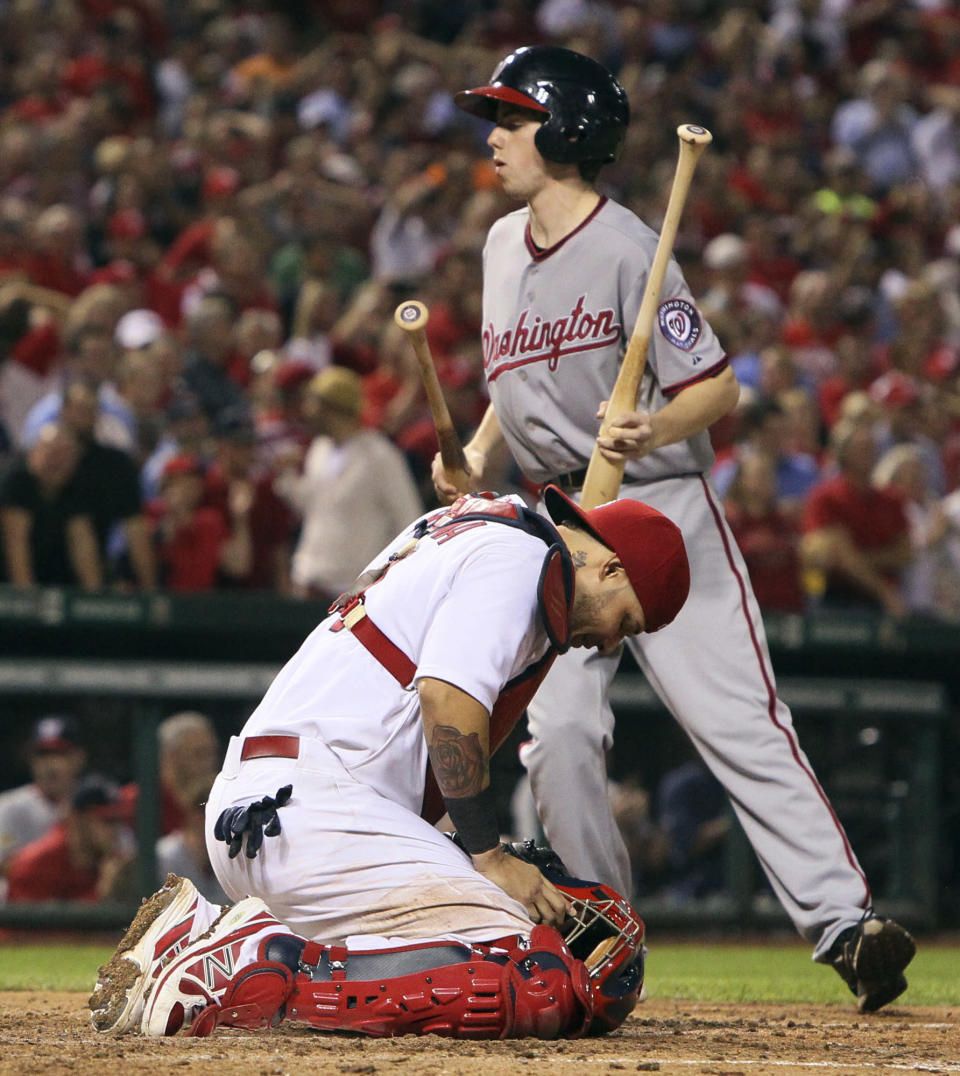St. Louis Cardinals catcher Yadier Molina reacts after Washington Nationals' Ryan Zimmerman hit an infield single to break up Michael Wacha's no-hit bid with two outs in the ninth inning of a baseball game Tuesday, Sept. 24, 2013, in St. Louis. The Cardinals won 2-0. (AP Photo/St. Louis Post-Dispatch, Chris Lee)