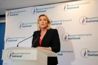 French far right leader Marine Le Pen reacts to the results of regional election, in Nanterre