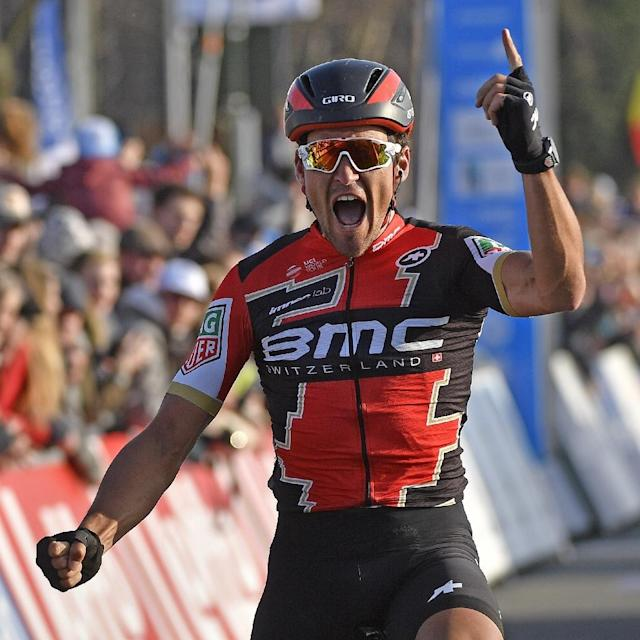 Belgian Greg Van Avermaet of BMC Racing Team celebrates as he crosses the finish line to win the 60th edition of the E3 Harelbeke cycling race, in Harelbeke, on March 24, 2017 (AFP Photo/ERIC LALMAND)