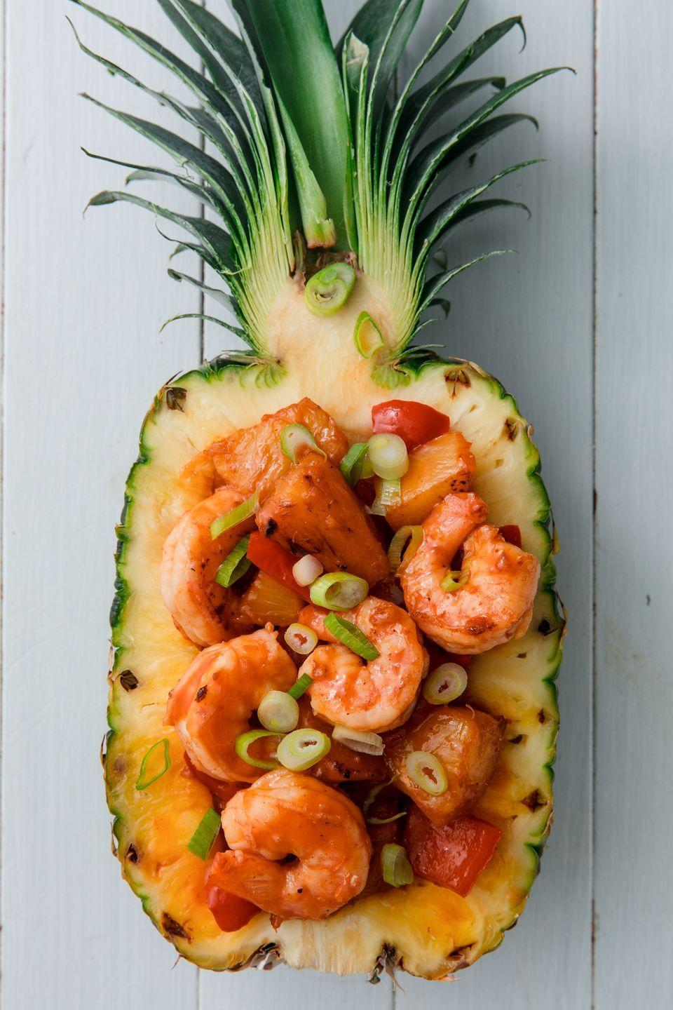 """<p>Pineapple boat optional, but recommended. </p><p>Get the recipe from <a href=""""https://www.delish.com/cooking/recipe-ideas/a22024504/best-pineapple-shrimp-recipe/"""" rel=""""nofollow noopener"""" target=""""_blank"""" data-ylk=""""slk:Delish."""" class=""""link rapid-noclick-resp"""">Delish.</a> </p>"""