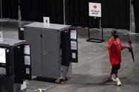 A man tries to vote but walks away after the machine stopped working during early voting at the State Farm Arena on Monday, Oct. 12, 2020, in Atlanta. (AP Photo/Brynn Anderson)
