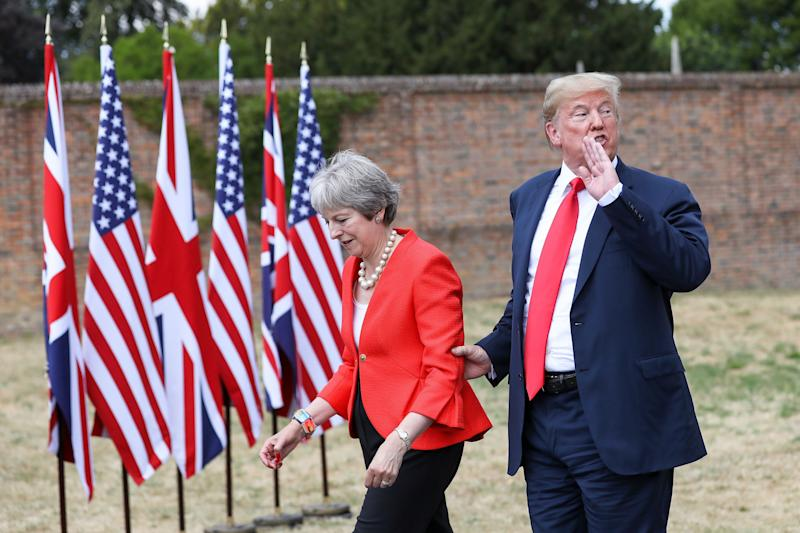 FILE: U.S. President Donald Trump, speaks to the media as he holds onto Theresa May, U.K. prime minister, following their joint news conference at Chequers in Aylesbury, U.K., on Friday, July 13, 2018. An emotional Theresa May announced she will quit as Britains prime minister after admitting she had failed to deliver the one task that defined her time in office -- taking the country out of the European Union. Photographer: Chris Ratcliffe/Bloomberg via Getty Images