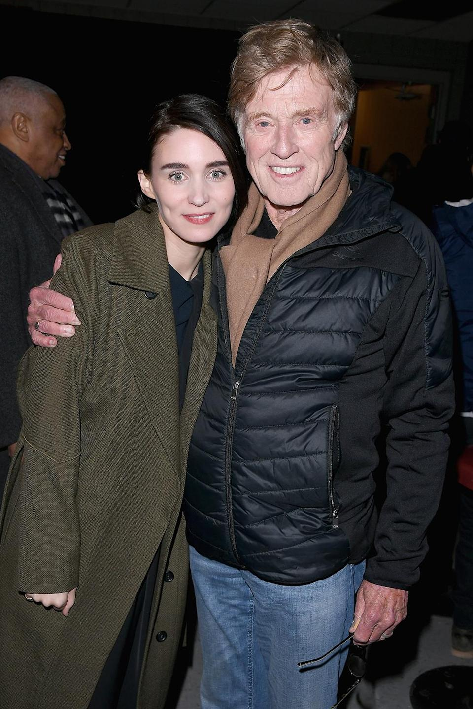 <p>Mara poses with co-star and Sundance founder Redford at 'The Discovery' premiere on Jan. 20. (Photo: George Pimentel/Getty Images) </p>