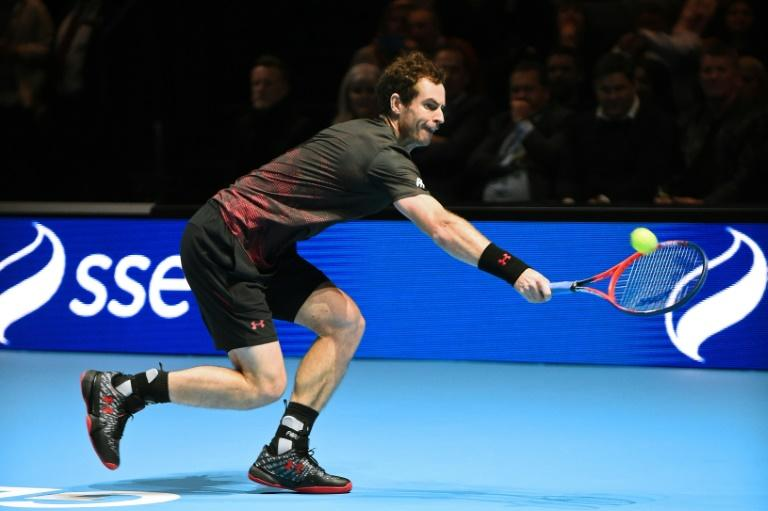 """Britain's Andy Murray returns to Switzerland's Roger Federer in their exhibition tennis singles match, during """"Andy Murray Live"""" at the SSE Hydro in Glasgow, Scotland on November 7, 2017"""