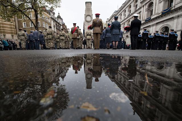 <p>Army, navy and RAF cadets stand to attention after a two-minute silence during the Western Front Association's (WFA) annual service of remembrance on Armistice Day, at the Cenotaph in central London on Nov. 11, 2017. (Photo: Chris J. Ratcliffe/AFP/Getty Images) </p>