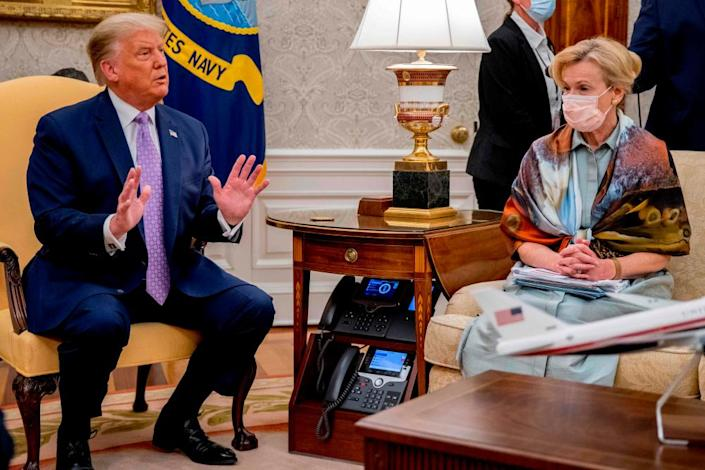"""<span class=""""element-image__caption"""">Birx with Trump at a Covid briefing on Wednesday.</span> <span class=""""element-image__credit"""">Photograph: Andrew Harnik/AFP/Getty Images</span>"""