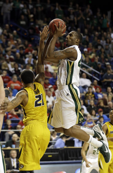 Colorado State forward Greg Smith, right, shoots as Missouri forward Laurence Bowers (21) defends during the first half their second-round NCAA college basketball tournament game on Thursday, March 21, 2013, in Lexington, Ky. (AP Photo/John Bazemore)