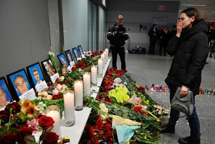 A woman in front of a memorial at the Boryspil airport outside Kiev for the victims of the Ukraine International Airlines Flight PS752 (AFP Photo/Sergei SUPINSKY)