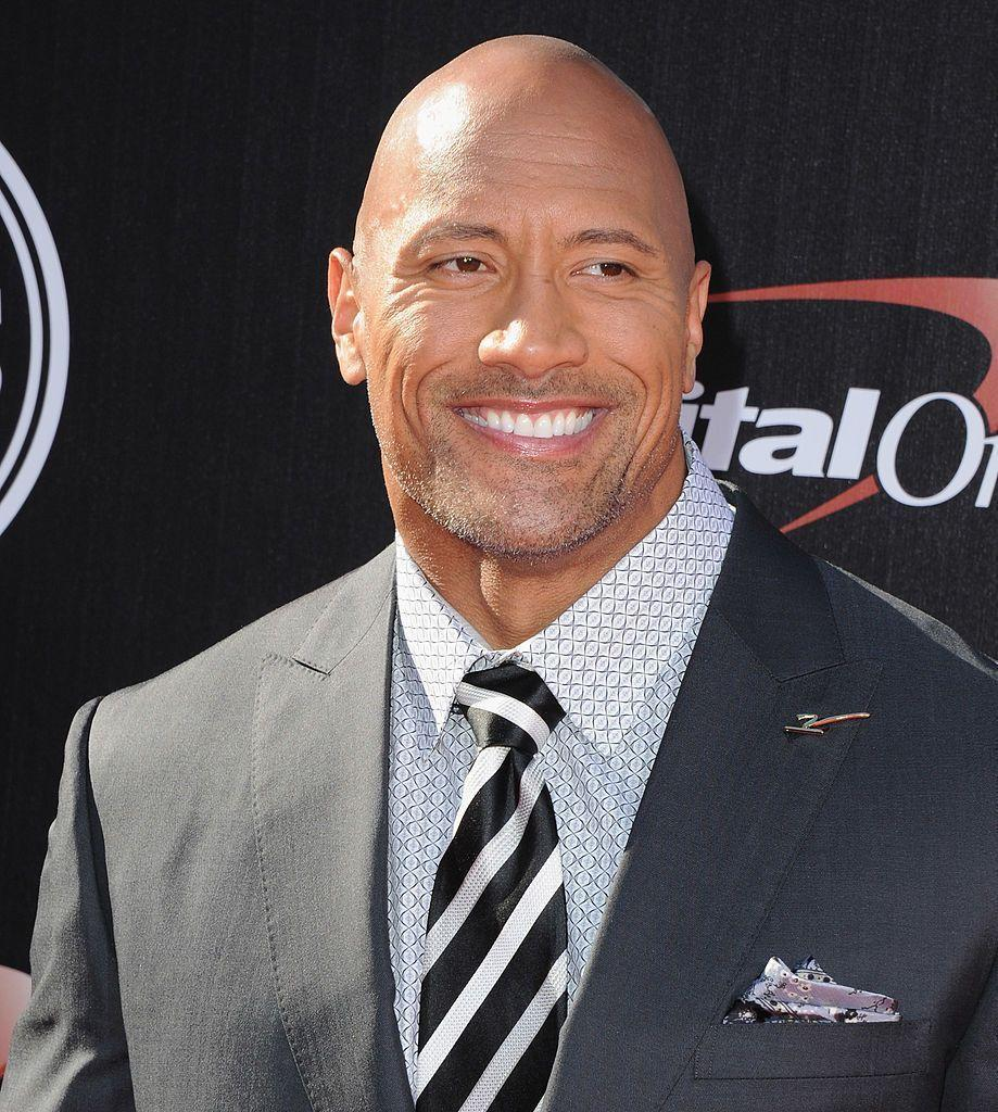 <p>Not only is the Rock, somehow, even better looking buzzed, he also, somehow, pulls off the subbled goatee. Not an easy feat. </p>