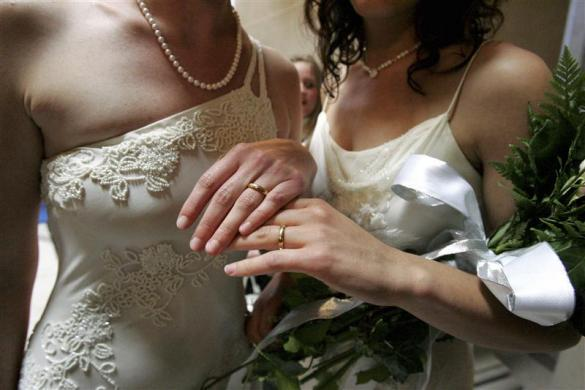 Sharon Papo (R) and her partner Amber Weiss display their wedding rings after exchanging wedding vows at City Hall on the first full day of legal same-sex marriages in San Francisco, California June 17, 2008. Gay marriage supporters see the move by the most populous U.S. state to allow same-sex weddings as an historic move long overdue, while opponents brand it a moral tragedy.