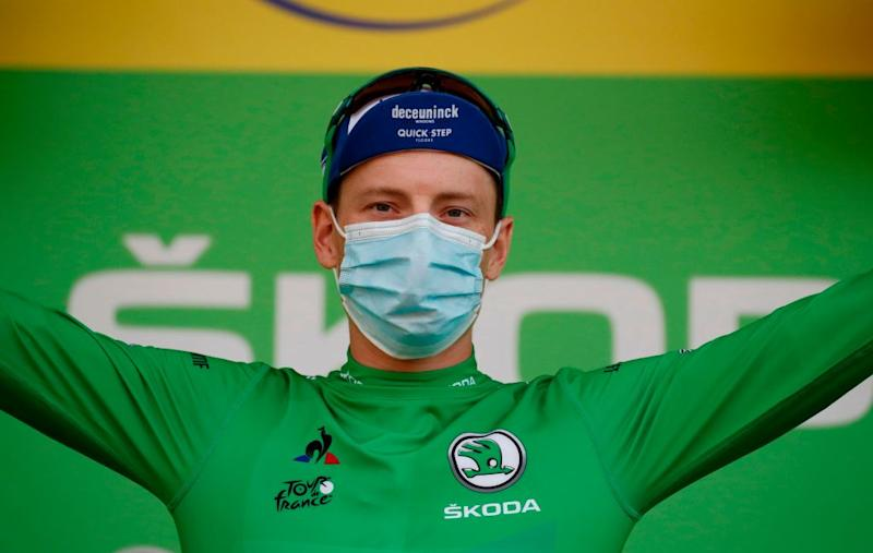 Team Deceuninck rider Irelands Sam Bennett celebrates his green jersey of best sprinter on the podium at the end of the 20th stage of the 107th edition of the Tour de France cycling race 36 km between Lure and La Planche des Belles Filles on September 19 2020 Photo by Sebastien Nogier POOL AFP Photo by SEBASTIEN NOGIERPOOLAFP via Getty Images