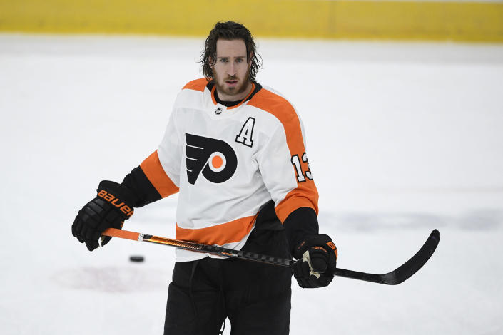 FILE - Philadelphia Flyers center Kevin Hayes (13) warms up before an NHL hockey game against the Washington Capitals in Washington, in this Tuesday, April 13, 2021, file photo. Kevin Hayes spent a life in step with big brother Jimmy, a couple of kids from Boston's largest neighborhood who attended the same boarding school, same college and, ultimately, played head-to-head in the NHL. In August, Kevin Hayes stood behind to a lectern inside a jammed Catholic parish, steeled his nerves and told mourners about the best brother in the world. (AP Photo/Nick Wass, File)