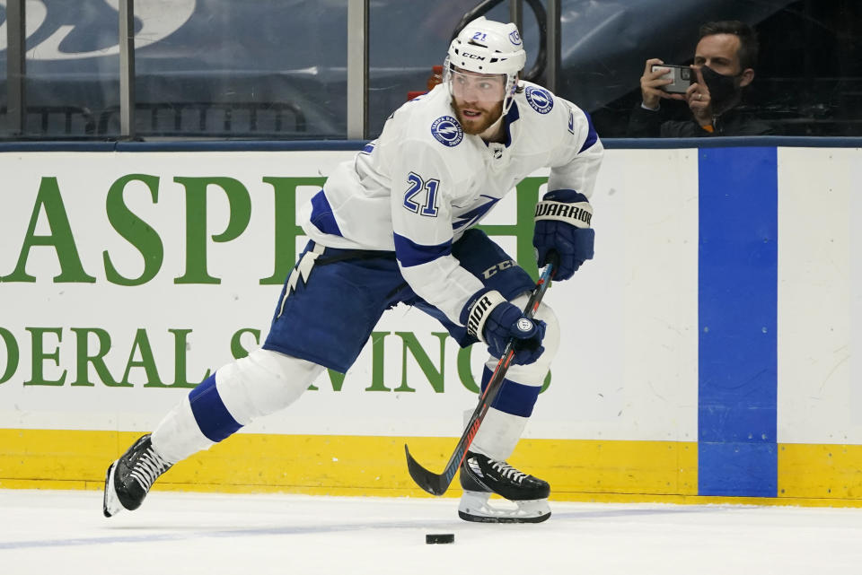 Tampa Bay Lightning center Brayden Point (21) brings the puck up the ice against the New York Islanders during the third period of Game 3 of the NHL hockey Stanley Cup semifinals, Thursday, June 17, 2021, in Uniondale, N.Y. Tampa Bay won 2-1.(AP Photo/Frank Franklin II)