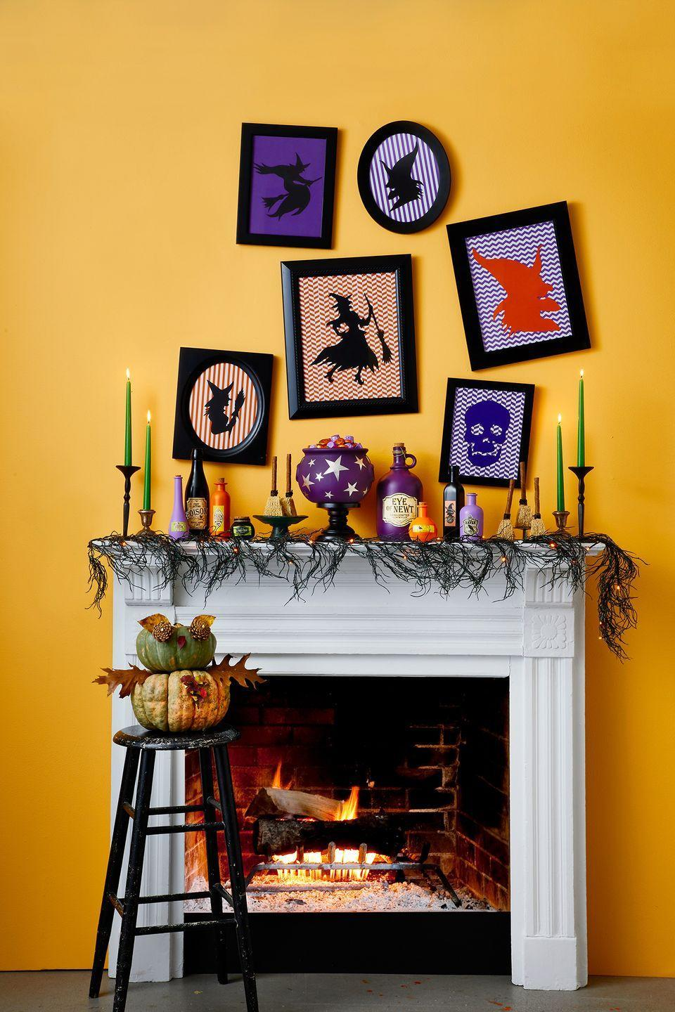 <p>Guests will freak out at this Halloween mantel setup, complete with skulls and witch graphics in striking black frames. </p>