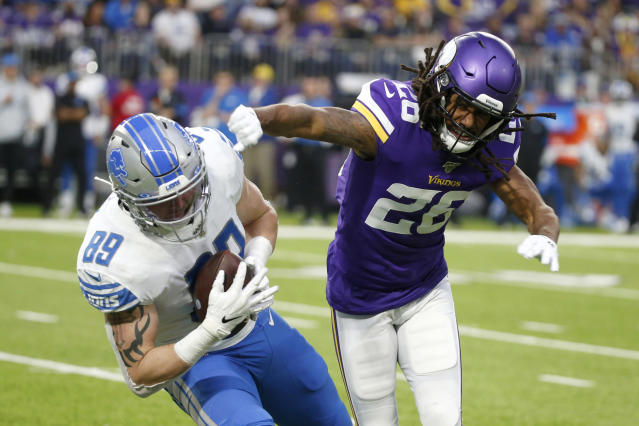 Detroit Lions tight end Isaac Nauta (89) is tackled by Minnesota Vikings cornerback Trae Waynes (26) after catching a pass during the second half of an NFL football game, Sunday, Dec. 8, 2019, in Minneapolis. (AP Photo/Bruce Kluckhohn)