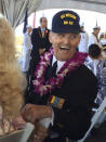 In this photo provided by Kathy Brent, World War II veteran Art Albert laughs during a surrender anniversary ceremony aboard the USS Missouri in Pearl Harbor, Hawaii, on Sept. 2, 2017. Albert, who had come to Hawaii for every commemoration, had promised loved ones that he would make it to the 75th anniversary of the surrender in 2020. But he died in June. Several dozen aging U.S. veterans will gather in Pearl Harbor in September to mark the event, even if it means the vulnerable group may be risking their lives again amid the coronavirus pandemic. (Kathy Bates via AP)