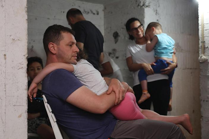 Image: People take shelter in the basement of a building in the Israeli coastal city of Tel Aviv in the early hours of May 13, 2021, after rockets were launched towards Israel from the Gaza Strip. (Gideon Markowicz / AFP - Getty Images)