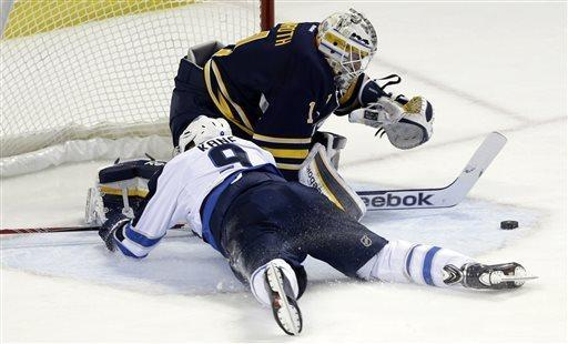 Buffalo Sabres goalie Jhonas Enroth of Sweden makes a save on a shot by Winnipeg Jets' Evander Kane (9) during the first period of an NHL hockey game in Buffalo, N.Y., Monday, April 22, 2013. Kane was tripped on the play and awarded a penalty shot. (AP Photo/David Duprey)