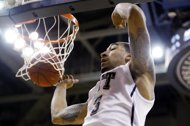 Pittsburgh's Cameron Wright finishes off a dunk against Fresno State in the first half of an NCAA college basketball game on Tuesday, Nov. 12, 2013, in Pittsburgh. (AP Photo/Keith Srakocic)