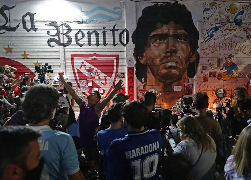 Fans in Buenos Aires pay tribute to their idolAFP via Getty Images